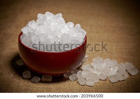 Bowl of rock sugar - stock photo