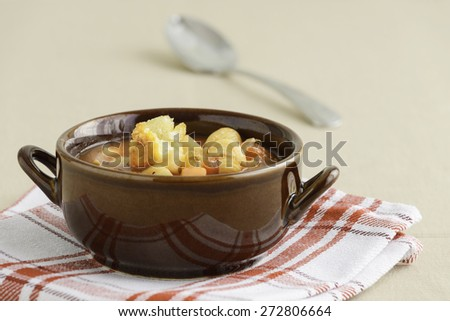 Bowl of rustic homemade minestrone soup with crouton. - stock photo
