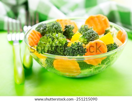 bowl of salad with broccoli, carrot, pumpkin and parsley