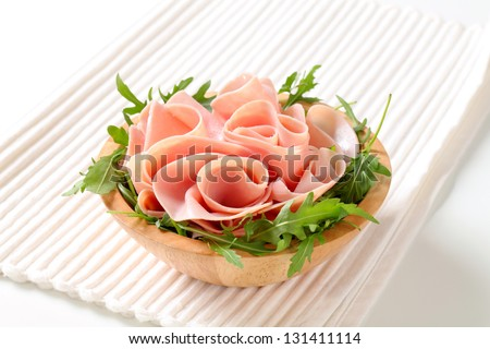 bowl of salad with fresh lean ham and arugula leaves - stock photo