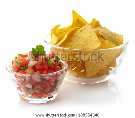 Bowl of salsa dip and nachos isolated on white background - stock photo