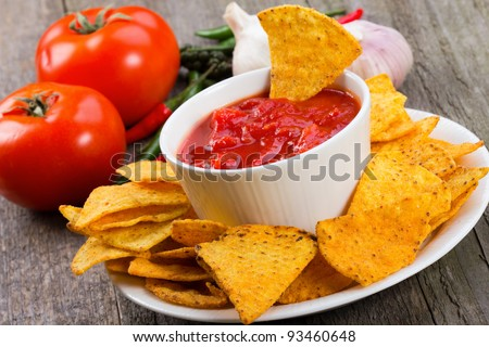 Bowl of salsa with tortilla chips - stock photo