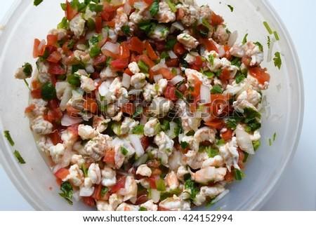 Bowl of Shrimp Ceviche with tomato, cilantro, jalapeno, onion and lemon - stock photo