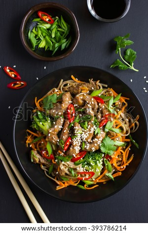 Bowl of soba noodles with beef and vegetables. Asian food. Top view. - stock photo