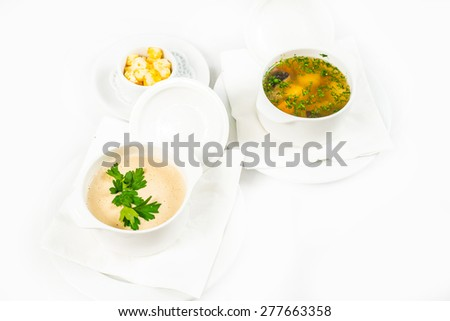 Bowl of soup with croutons on white background - stock photo