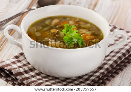 Bowl of Soup with Lentils, Beans, Chicken and Vegetables. Selective focus
