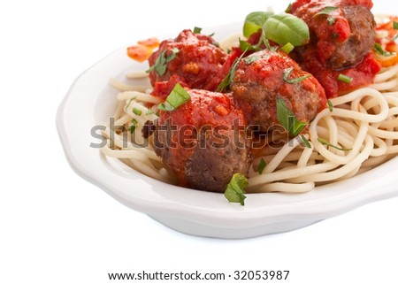bowl of spaghetti with meatballs in tomato sauce and basil - stock photo