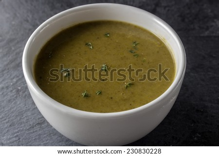 Bowl of spinach and bok choi soup with thyme  - stock photo