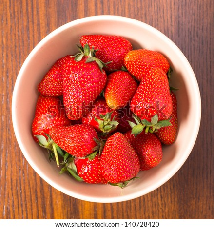 Bowl of strawberries top view - stock photo