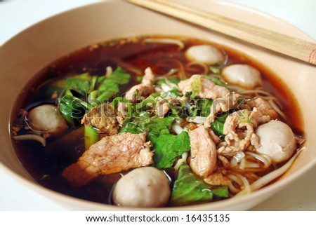 bowl of thai style beef noodle soup - stock photo