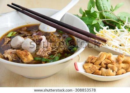 bowl of thai style beef noodle soup,Boat Noodle , Moo nam tok. - stock photo
