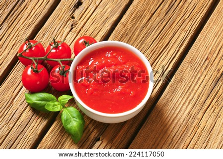 Bowl of thick tomato passata - stock photo