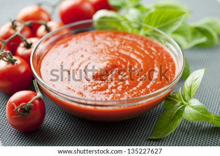 bowl of tomato pulp, pure, sauce, basil leaves