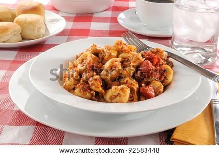 Bowl of tortellini with roasted tomato pesto - stock photo