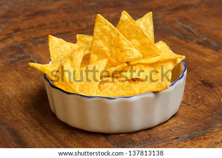 bowl of tortilla chips on wooden background - stock photo