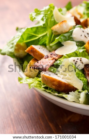 Bowl of Traditional Caesar Salad with Chicken and Bacon - stock photo