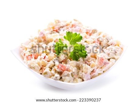 bowl of traditional russian salad on white background