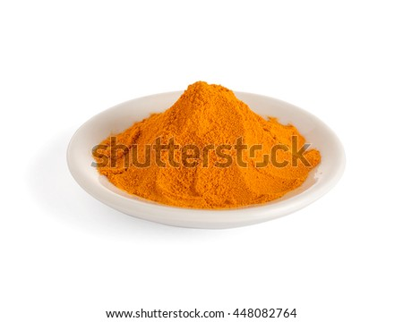 Bowl of turmeric powder