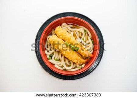 Bowl of udon noodles with fried shrimp isolated on white background