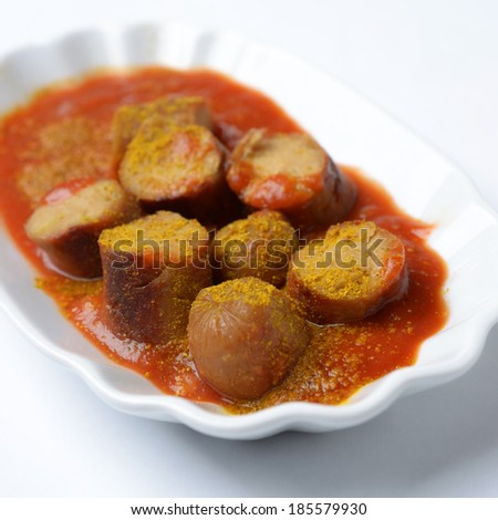 bowl of vegan curry sausage - stock photo