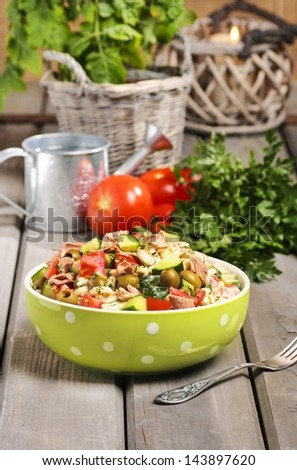Bowl of vegetable salad on wooden table