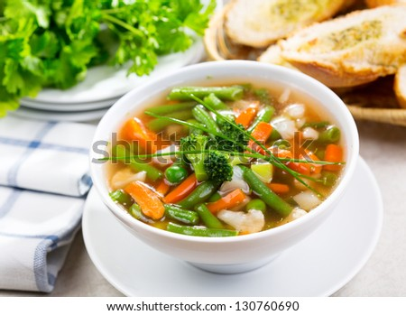 bowl of vegetable soup with parsley