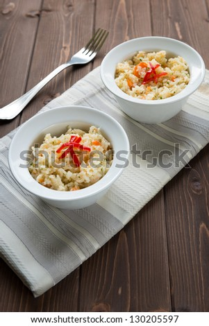Bowl of vegetarian rice on wood table
