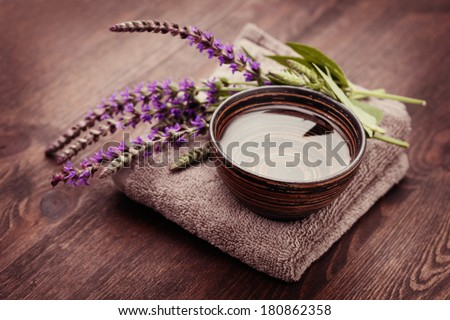 bowl of water and fresh sage - beauty treatment - stock photo