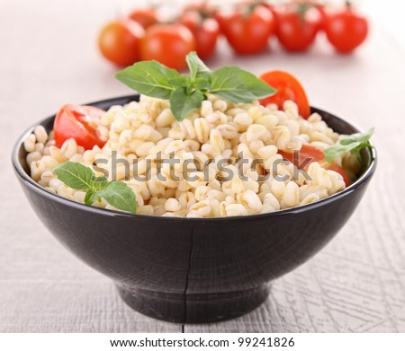bowl of wheat, tomato and basil