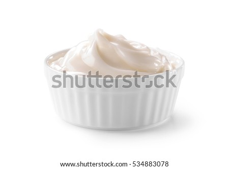 bowl of whipped cream close-up isolated on white background