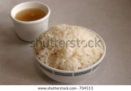 Bowl of white rice and green tea in a chineese resturant