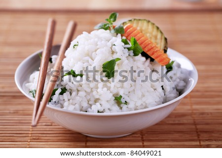 Bowl of white rice and wooden chopsticks