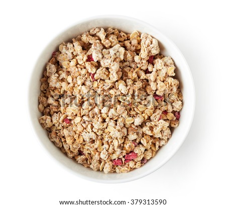 Bowl of whole grain muesli isolated on white background, top view
