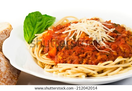 Bowl of whole wheat spaghetti and sauce. The sauce includes ground turkey, fresh basil, tomato sauce, bell peppers, onions, mushrooms, garlic, olive oil and italian seasonings.  - stock photo