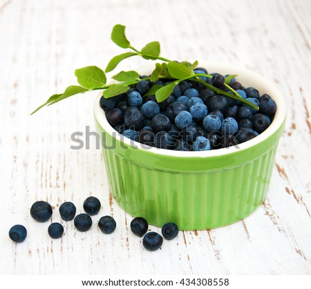 Bowl with Blueberries on a old wooden background