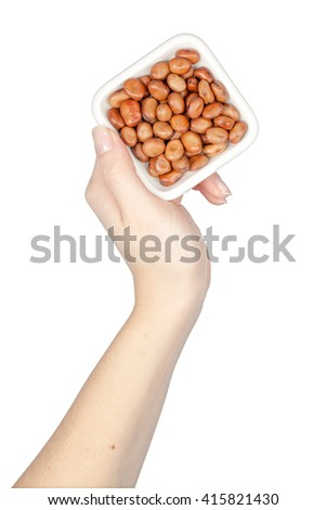 bowl with broad beans in a hand isolated on white background. legumes - stock photo