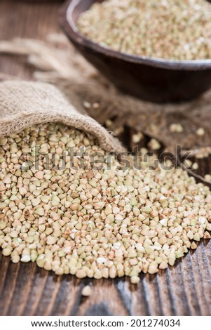 Bowl with Buckwheat (detailes close-up shot) on wooden background