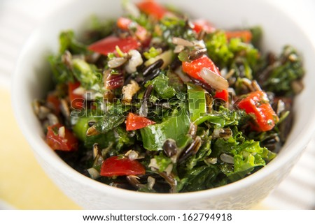 Bowl with Chopped Kale, Chard, and Peppers Salad with Wild Rice - stock photo