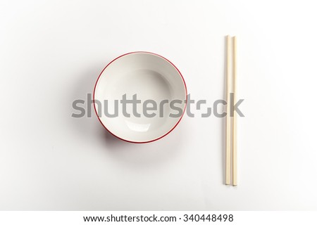 bowl with chopsticks on a white background - stock photo