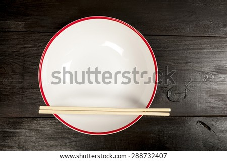 bowl with chopsticks on a wooden table