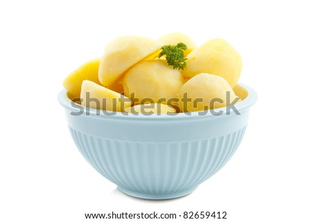 Bowl with cooked potato isolated over white - stock photo