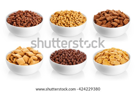 Bowl with corn pads, rings, balls and cornflakes isolated on white background. Cereals breakfast collection. - stock photo