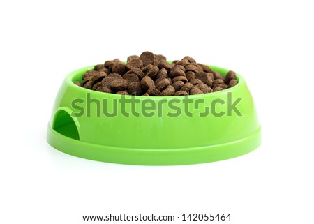 bowl with dry food for dog or cat isolated on white background - stock photo