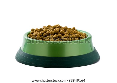 bowl with dry food for dog or cat isolated on white background. - stock photo