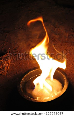Bowl with fire on the ground