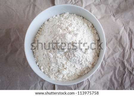 Bowl with flour. - stock photo