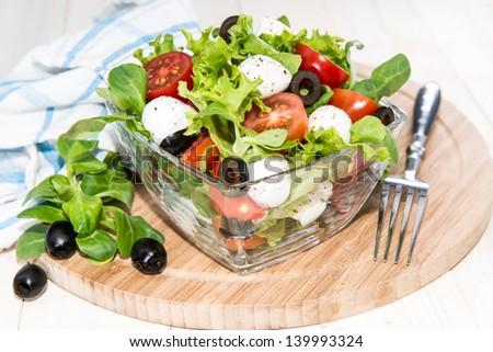 Bowl with fresh and healthy Tomato-Mozzarella Salad - stock photo