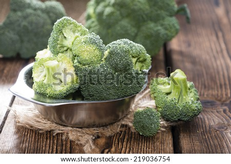 Bowl with fresh Broccoli on wooden background (close-up shot) - stock photo