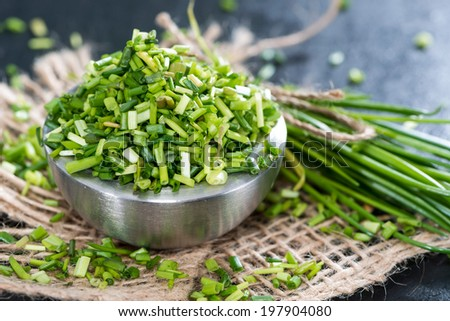 Bowl with fresh cutted Chives (on dark background) - stock photo