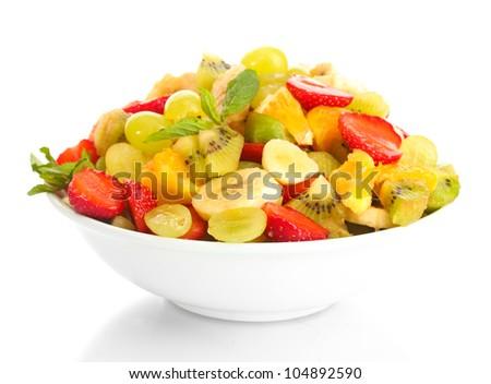 bowl with fresh fruits salad  isolated on white - stock photo